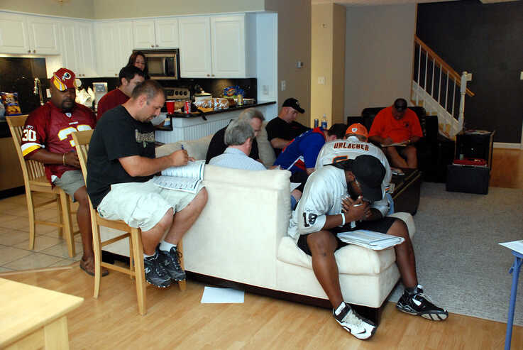 FILE -- Many fantasy football leagues hold draft parties, when league players get together to select their team's players before the start of the season.  (Photo by Flickr user David Clow via Creative Commons license)