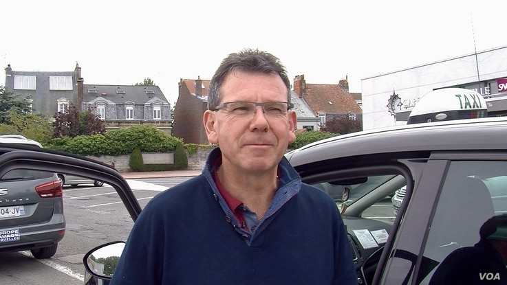 Taxi driver Hugues Vanpeene hopes Brexit will reinstate a duty free zone that once attracted British tourists. (L. Bryant/VOA)