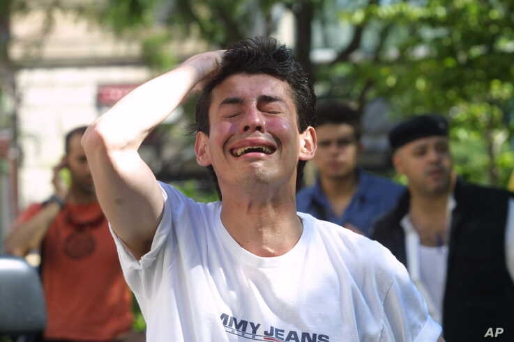A man cries on Sept. 11, 2001 after witnessing the collapse of the north tower of the World Trade Center in New York City.