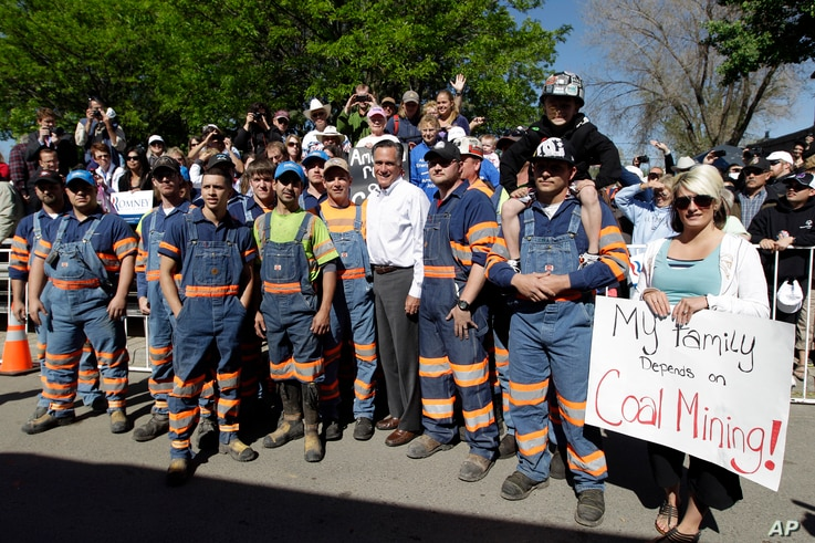 Coal miner stand with Republican presidential candidate, former Massachusetts Gov. Mitt Romney when he campaigned in Craig, Colo., May 29, 2012.