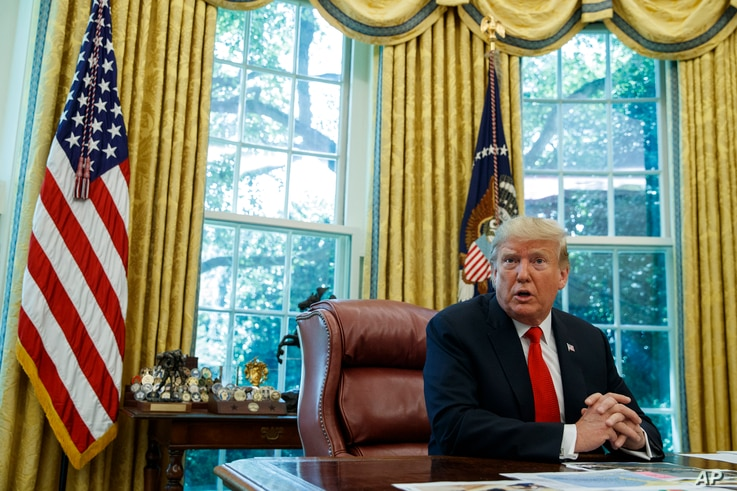 FILE - President Donald Trump talks with reporters in the Oval Office of the White House, Sept. 4, 2019.