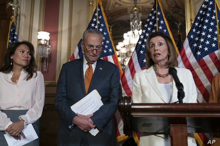 Speaker of the House Nancy Pelosi, D-Calif., right, and Senate Minority Leader Chuck Schumer, D-N.Y., call for a Senate vote on the House-passed Bipartisan Background Checks Act to address gun violence, at the Capitol in Washington, Sept. 9, 2019.