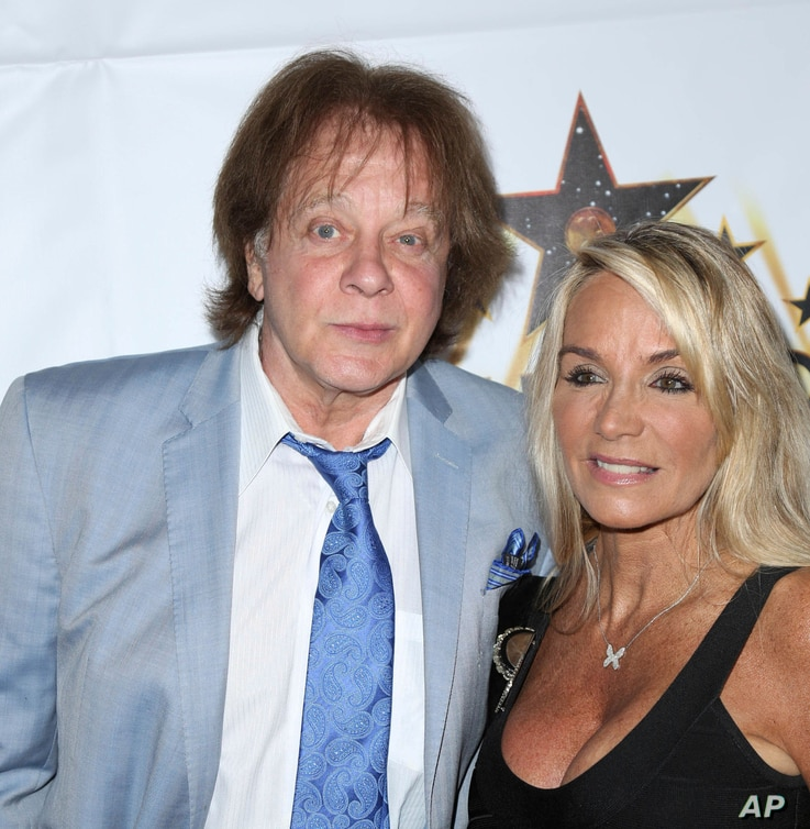 FILE - Money and his wife Laurie Harris Money are seen at The Hollywood Walk Of Fame Honors outside the Taglyan Complex in Hollywood, California, Oct. 25, 2016.