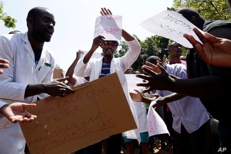 A group of Zimbabwean doctors sing as they protest at Parirenyatwa hospital in Harare, Zimbabwe, Sunday, Sept. 15, 2019.
