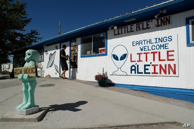 """A person walks into the Little A'Le'Inn, Wednesday, Sept. 18, 2019, in Rachel, Nev. No one knows what to expect, but lots of people are preparing for """"Storm Area 51"""" in the Nevada desert."""