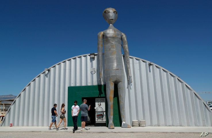 """People enter and exit the Alien Research Center in Hiko, Nev. No one knows what to expect, but lots of people are preparing for """"Storm Area 51"""" on Wednesday, Sept. 18, 2019, in the Nevada desert."""