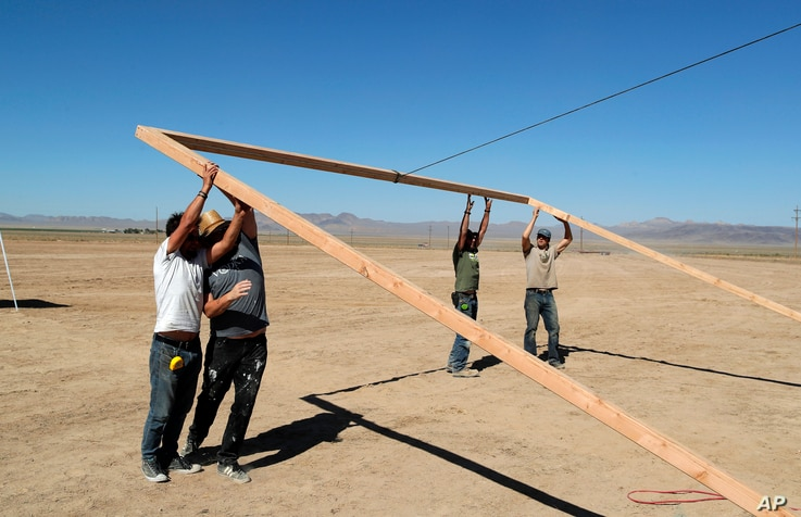 """Workers erect a stage at the Little A'Le'Inn on Wednesday, Sept. 18, 2019, in Rachel, Nev. No one knows what to expect, but lots of people are preparing for """"Storm Area 51"""" in the Nevada desert."""