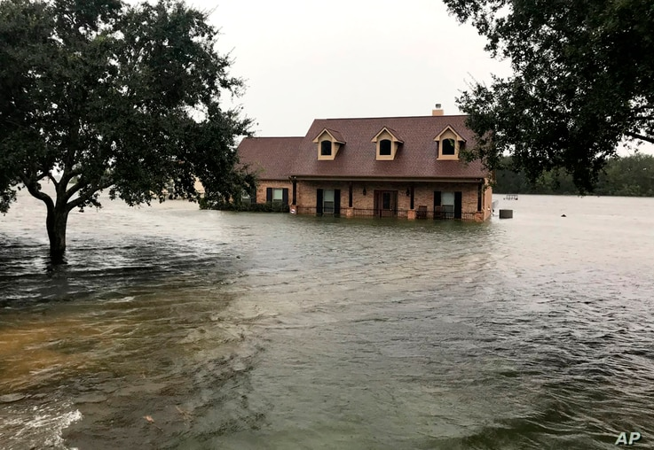 Floodwaters surround a home in Winnie, Texas, Sept 19, 2019.