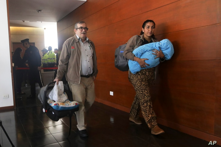 Accompanied by his wife Johana Castro and their child, former rebel leader commander Rodrigo Londono arrives to appear before Colombia's special peace tribunal inBogota, Colombia, Sept. 23, 2019.