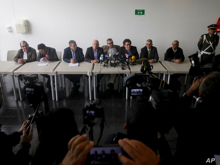 Former rebel commanders hold a press conference after appearing at a special peace tribunal to testify in an ongoing probe of their role in civilian kidnappings in Bogota, Colombia, Monday, Sept. 23, 2019.