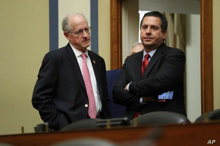 Ranking member Rep. Devin Nunes, R-Calif., talks to Rep. Mike Conaway, R-Texas, after acting Director of National Intelligence Joseph Maguire testified before the House Intelligence Committee on Capitol Hill in Washington, Sept. 26, 2019.