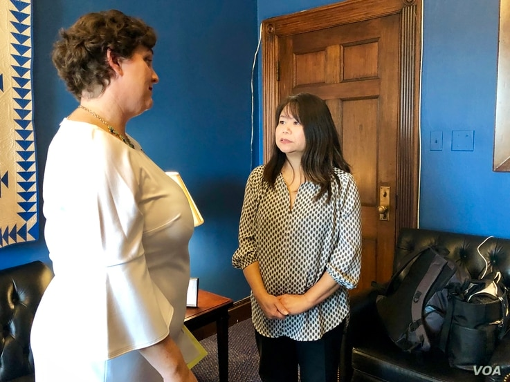 Rep. Katie Porter with her guest for the State of the Union speech, constituent Helen Nguyen.