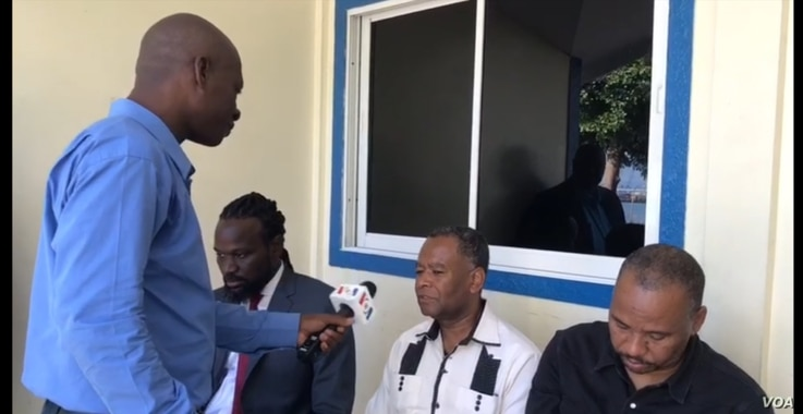 VOA Creole reporter Renan Toussaint interviews Opposition Senators (Left to Right), Antonio Cheramy, Ricard Pierre and Nenel Cassy who are camped out in front of the Senatè, Sept 23, 2019 in Port au Prince, Haiti.