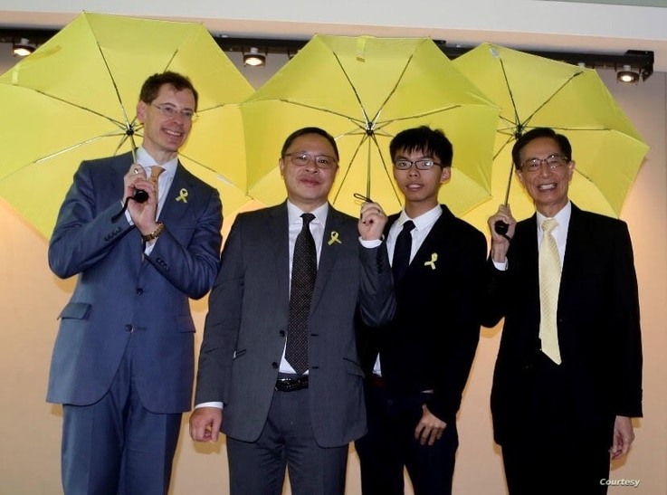 FILE - Joshua Wong, 3rd from left, stands with, from left, Mark Lagon, then-president of Freedom House; Benny Tai, law professor in Hong Kong; and Martin Lee, founder of Hong Kong Democratic Party, at a 2015 event in Washington. (Courtesy of Freedom House)