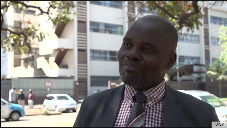 Kingstone Magombeyi, the father of Dr. Peter Magombeyi, acting president of the Zimbabwe Hospital Doctors Association, speaks in Harare, Sept. 26, 2019. (C. Mavhunga/VOA)