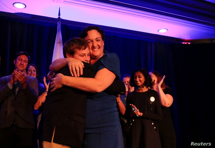 Democratic congressional candidate Katie Porter hugs her son at the end of her midterm election night party in Irvine, California, U.S. November 6, 2018.