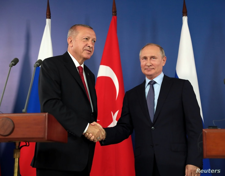 FILE - Russian President Vladimir Putin, right, and his Turkish counterpart Recep Tayyip Erdogan shake hands during a joint news conference in Zhukovsky outside Moscow, Russia, Aug. 27, 2019.