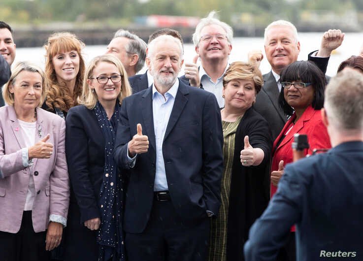 Britain's opposition Labour Party leader Jeremy Corbyn poses with members of his shadow cabinet following their meeting in Salford, Britain, Sept. 2, 2019.