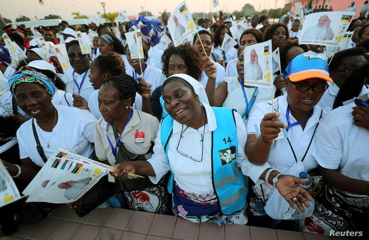 Women sing as they await the arrival of Pope Francis in Maputo, Mozambique, Sept. 4, 2019.