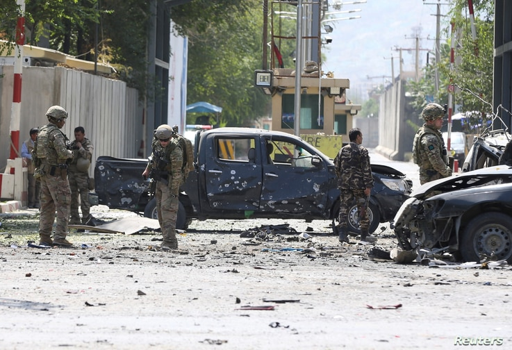 Foreign troops with NATO-led Resolute Support Mission investigate at the site of a suicide attack in Kabul, Afghanistan, Sept. 5, 2019.