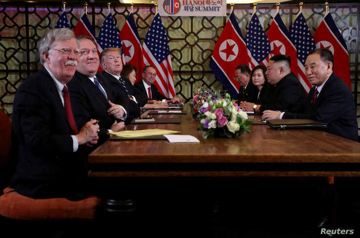 John Bolton, left, and others attend an extended bilateral meeting between North Korea's leader Kim Jong Un and U.S. President Donald Trump, in Hanoi, Vietnam Feb. 28, 2019.