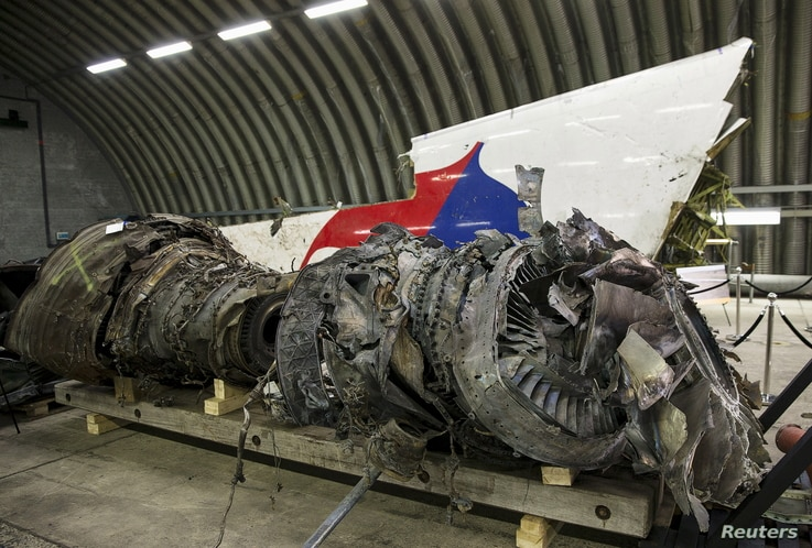 FILE - Wreckage of the MH17 airplane is seen after the presentation of the final report into the crash of July 2014 of Malaysia Airlines Flight MH17 over Ukraine in Gilze Rijen, the Netherlands, Oct. 13, 2015.