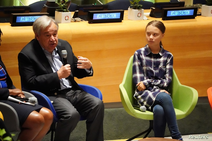 Swedish climate activist Greta Thunberg speaks with other child petitioners from 12 countries who presented a landmark complaint to protest the lack of government action on the climate crisis during a press conference in New York, Sept. 23, 2019.