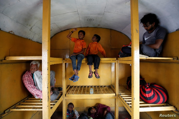 Siddharth Dhage, 10, and his neighbor Gaurav Ganesh, 13, sit in the luggage compartment of a train on their journey back to Mukundwadi railway station, in Aurangabad, India, July 18, 2019.Siddharth Dhage, 10, and his neighbour Gaurav Ganesh, 13, sit in the luggage compartment of a train on their journey back to Mukundwadi railway station, in Aurangabad, India, July 18, 2019.