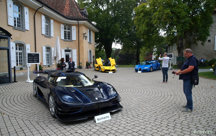 A Koenigsegg One:1 (2015), a Ferrari LaFerrari (2015) and a Bugatti Veyron EB 16.4 Coupe (2010), part of a collection of luxury cars owned by Teodoro Obiang, the son of the Eq. Guinea president, confiscated the  Swis prosecutor in Geneva, Sept. 27, 2019.