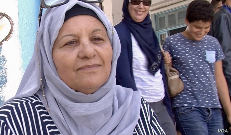 Zohra Goummid is voting for Prime Minister Youssef Chahed for president, Tunis, Sept. 15, 2019. (Photo: L. Bryant/VOA)