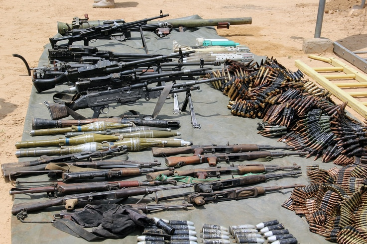 FILE - Arms and ammunitions recovered from Boko Haram militants are displayed in Goniri, Yobe State, in Nigeria's restive northeast, July 3, 2019.