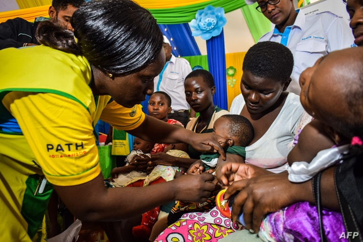 A health worker vaccinates a child against malaria, in Ndhiwa, Homabay County, western Kenya, Sept. 13, 2019, during the launch of a malaria vaccination campaign in the country.