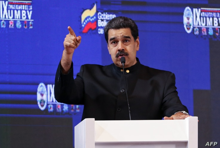 Handout picture released by the Venezuelan Presidency showing Venezuelan President Nicolas Maduro speaking during the IX anniversary of the Bolivarian Military University of Venezuela in Caracas, Sept. 3, 2019.