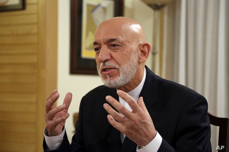 Former Afghan President Hamid Karzai speaks during an interview in Kabul, Afghanistan, Sept. 24, 2019.