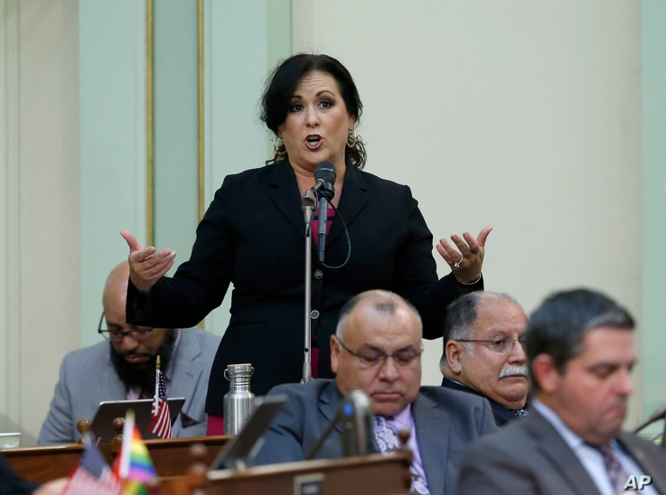 FILE - Assemblywoman Lorena Gonzalez, D-San Diego, urges lawmakers to approve her measure to give new wage and benefit protections at the so-called gig economy companies like Uber and Lyft, during the Assembly session in Sacramento, Sept. 11, 2019