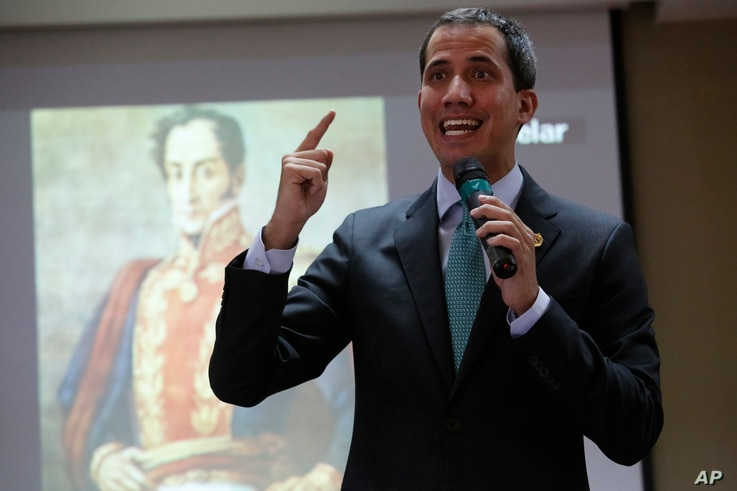 Opposition leader and self-proclaimed interim president of Venezuela, Juan Guaido, addresses lawmakers during a session at the administrative headquarters of the National Assembly, in front of an image of Venezuelan independence hero Simon Bolivar, in Caracas, Venezuela, Sept. 3, 2019.