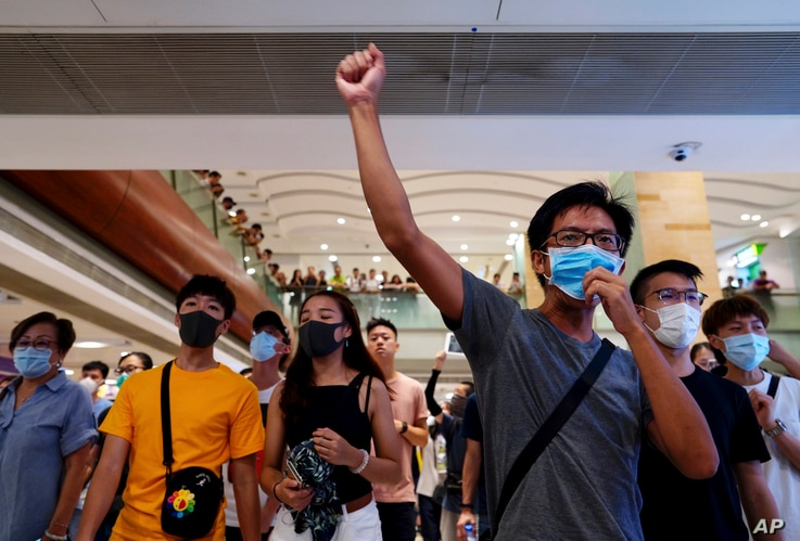 With access to the airport restricted, protesters shout slogans at a shopping mall in Hong Kong, Sept. 7, 2019.