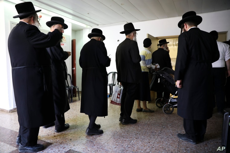 Ultra orthodox Jews line up to vote in Bnei Brak, Israel, Sept. 17, 2019.