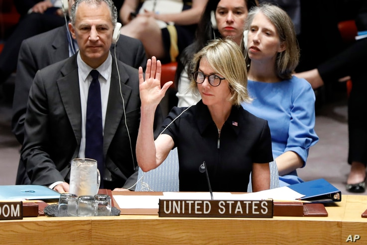 New U.S. Ambassador Kelly Knight Craft raises her hand for her first vote as she attends her first Security Council meeting, at United Nations headquarters, in New York, Sept. 12, 2019.