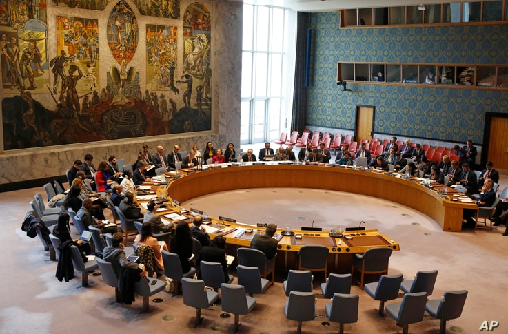 Members of the U.N. Security Council gather inside the United Nations Security Council chambers in New York, for a meeting on Syria, April 30, 2019.
