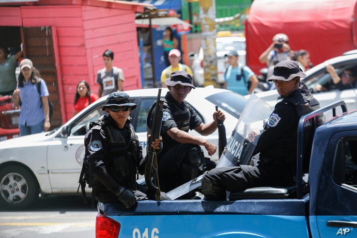 Police patrol outside the Central American University (UCA), where students are protesting to demand the release of political prisoners, in Managua, Nicaragua, June 18, 2019.