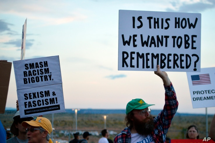 FILE - Protesters demonstrate outside the Santa Ana Star Center during President Donald Trump's rally in Rio Rancho, New Mexico, Sept. 16, 2019.
