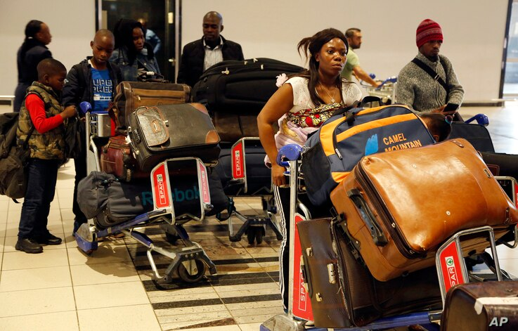 Nigerians queue at passport control at the O.R. Tambo International Airport in Johannesburg, South Africa, Sept. 11, 2019.