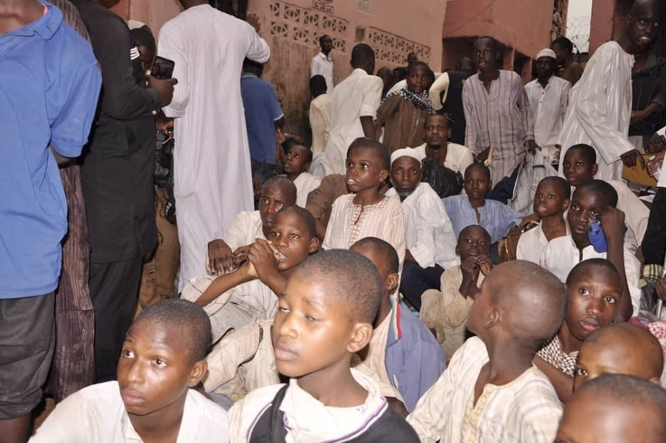 Young men and boys watch as staff members get interrogated during a police raid at an Islamic school in Kaduna, Nigeria, Sept. 26, 2019. (Courtesy - Nigerian Police)