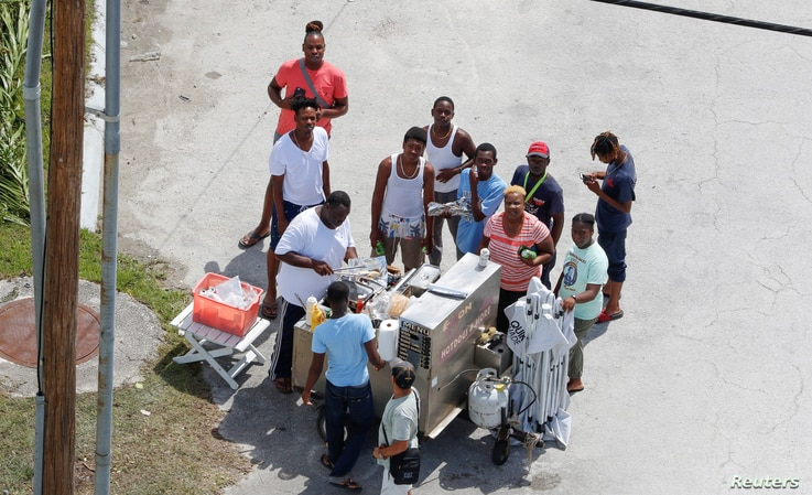 An aerial view shows people lining up for food after Hurricane Dorian hit the Grand Bahama Island, in the Bahamas, Sept. 4, 2019.
