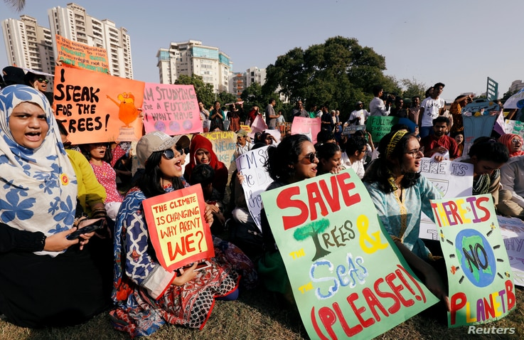 Activists call for action against climate change at a rally in Karachi, Pakistan, Sept. 20, 2019.