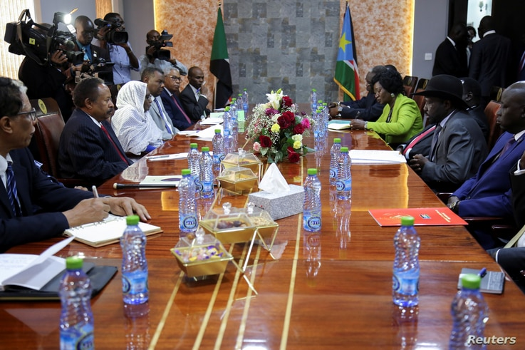 South Sudan's President Salva Kiir (C-R) and Sudan's Prime Minister Abdalla Hamdok (C-L) are seen flanked by aides during their meeting in Juba, South Sudan, Sept. 12, 2019.