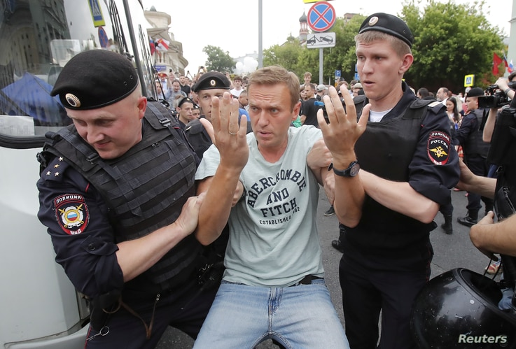 Police detain Russian opposition leader Alexei Navalny during a rally in Moscow, Russia, June 12, 2019.