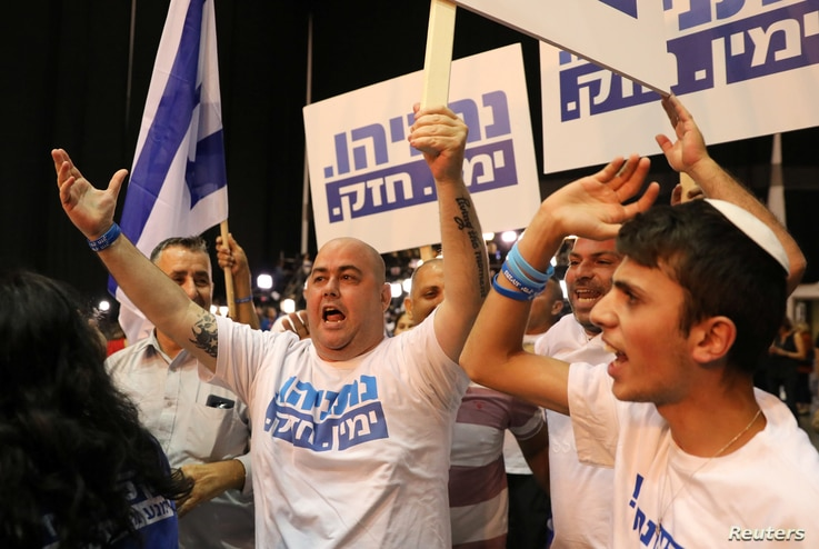 Supporters of Israeli Prime Minister Benjamin Netanyahu's Likud party react to exit polls in Israel's parliamentary election at the party headquarters in Tel Aviv, Israel, Sept. 17, 2019.