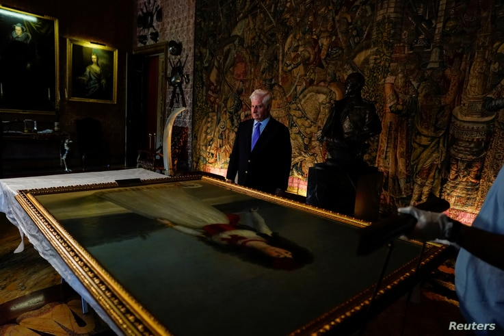 "Carlos Fitz-James Stuart, Duke of Alba stands behind ""XIII Duchess of Alba"" painting by the Spanish painter Francisco Goya at Liria Palace in Madrid, Spain, Sept. 9, 2019."